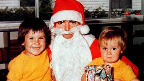 Santa Claus gives the young Roar supporter on the right a season pass and the one on the left nothing.