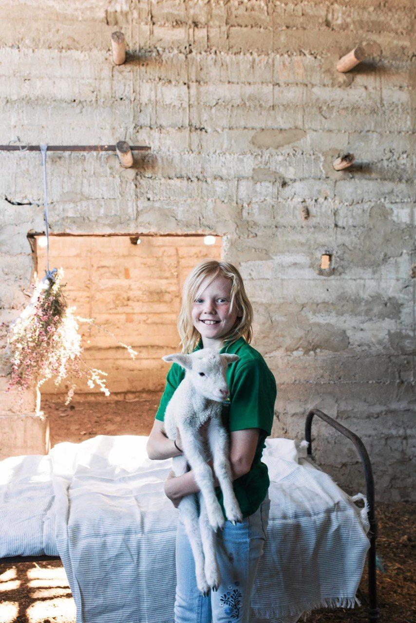 MATES: Georgi worked with Al the lamb for the photo shoot.