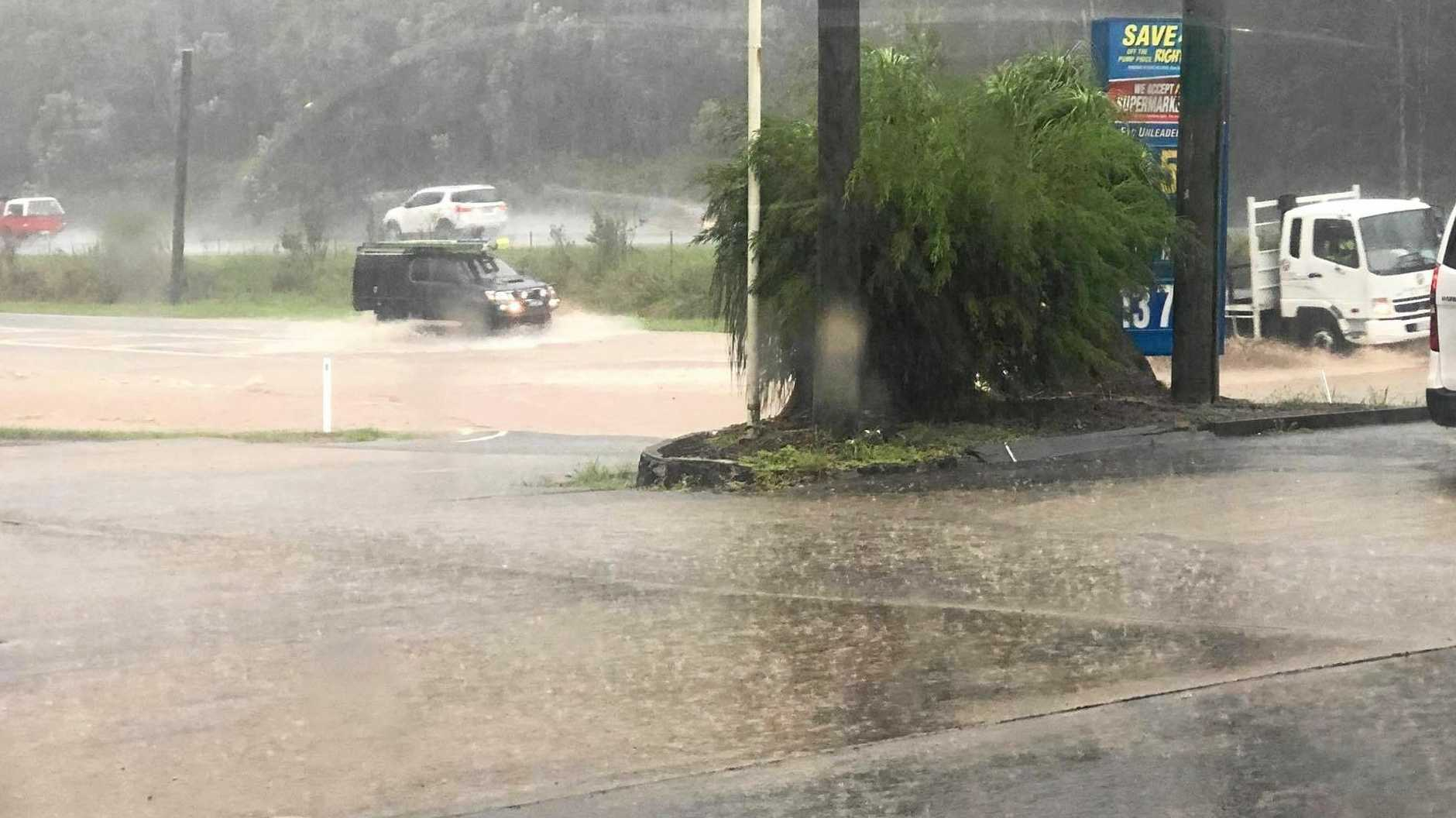 FLOOD WATCH: Several roads at Yandina were underwater after heavy rain this morning.