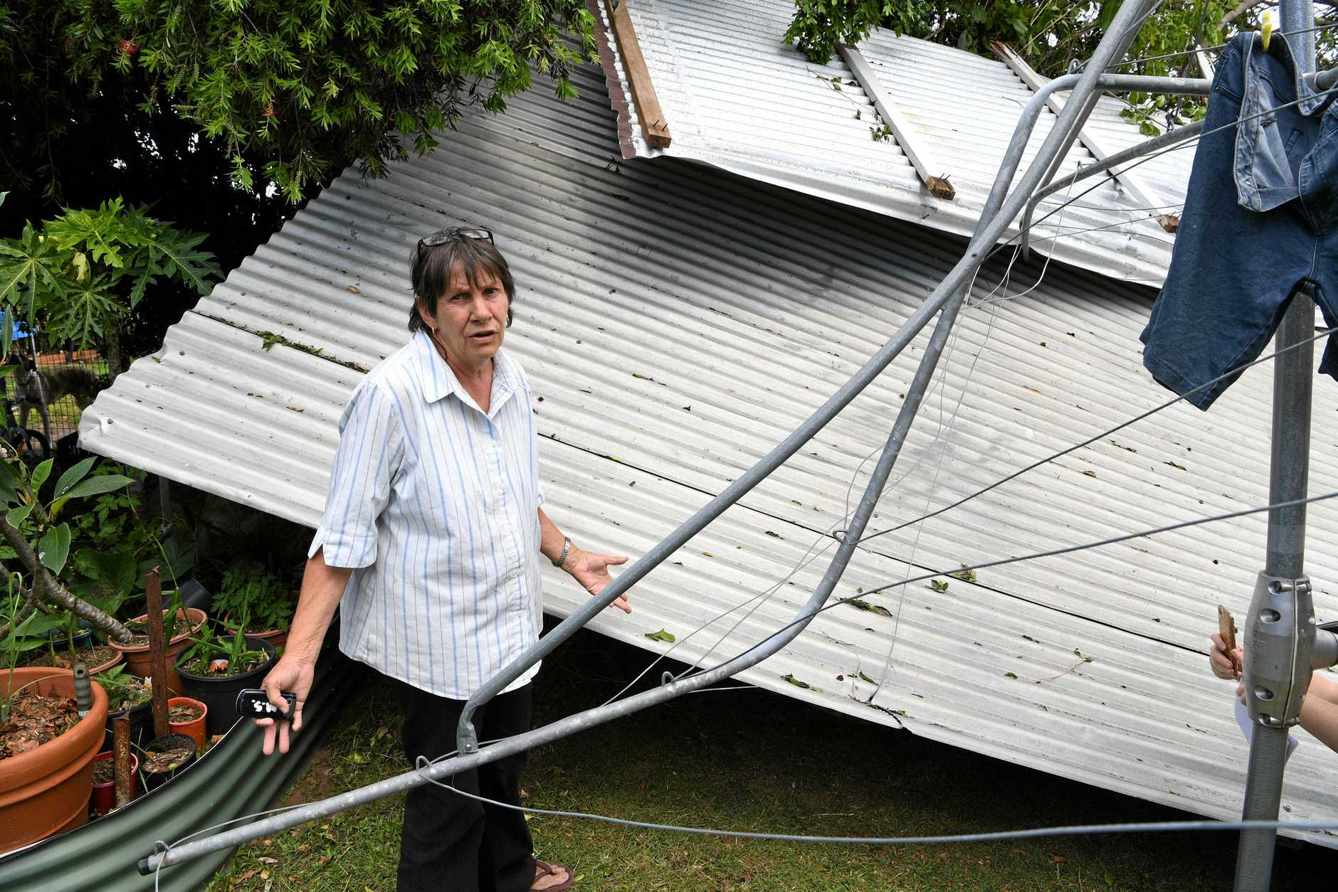 WILD WEATHER: Marilyn Smith discovered a neighbour's shed in her backyard after a storm in November last year.