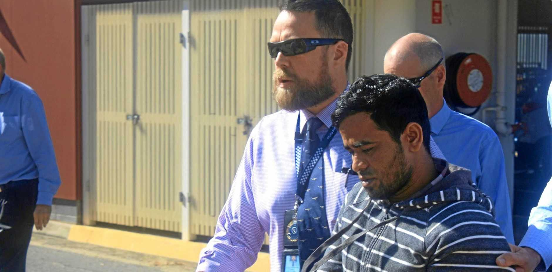 MURDER CHARGE: Mohammed Khan when he was arrested in relation to the death of Syeid Alam escorted from the Rockhampton Police Station to watch house at the Rockhampton Courthouse.