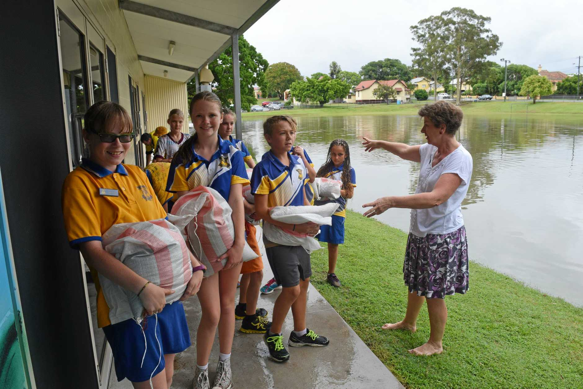 Central State School principal Lee Lilburne got her Year 6 students to help sandbag as pouring rains threatened to flood their hall.