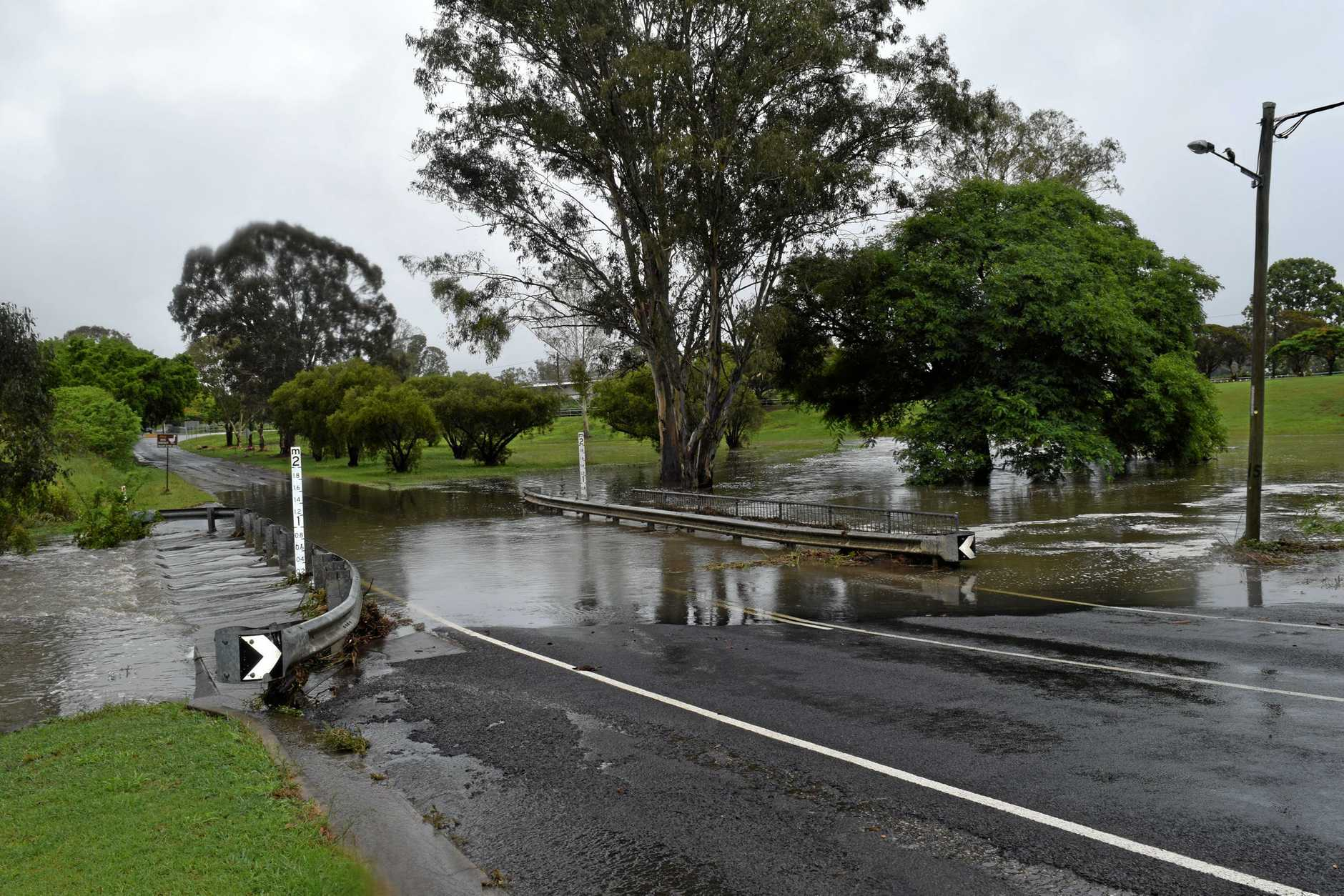 Flash flooding from more than 100mm of rain caused Fraser Coast Regional Council to close Queen St near Lions Dr in Maryborough on Friday, December 14.