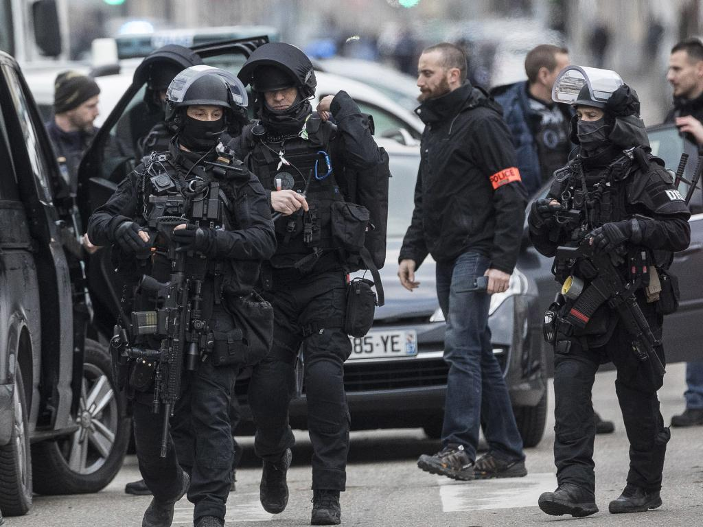 French police forces take position in the Neudorf district of Strasbourg, eastern France. Picture: AP/Jean-Francois Badias