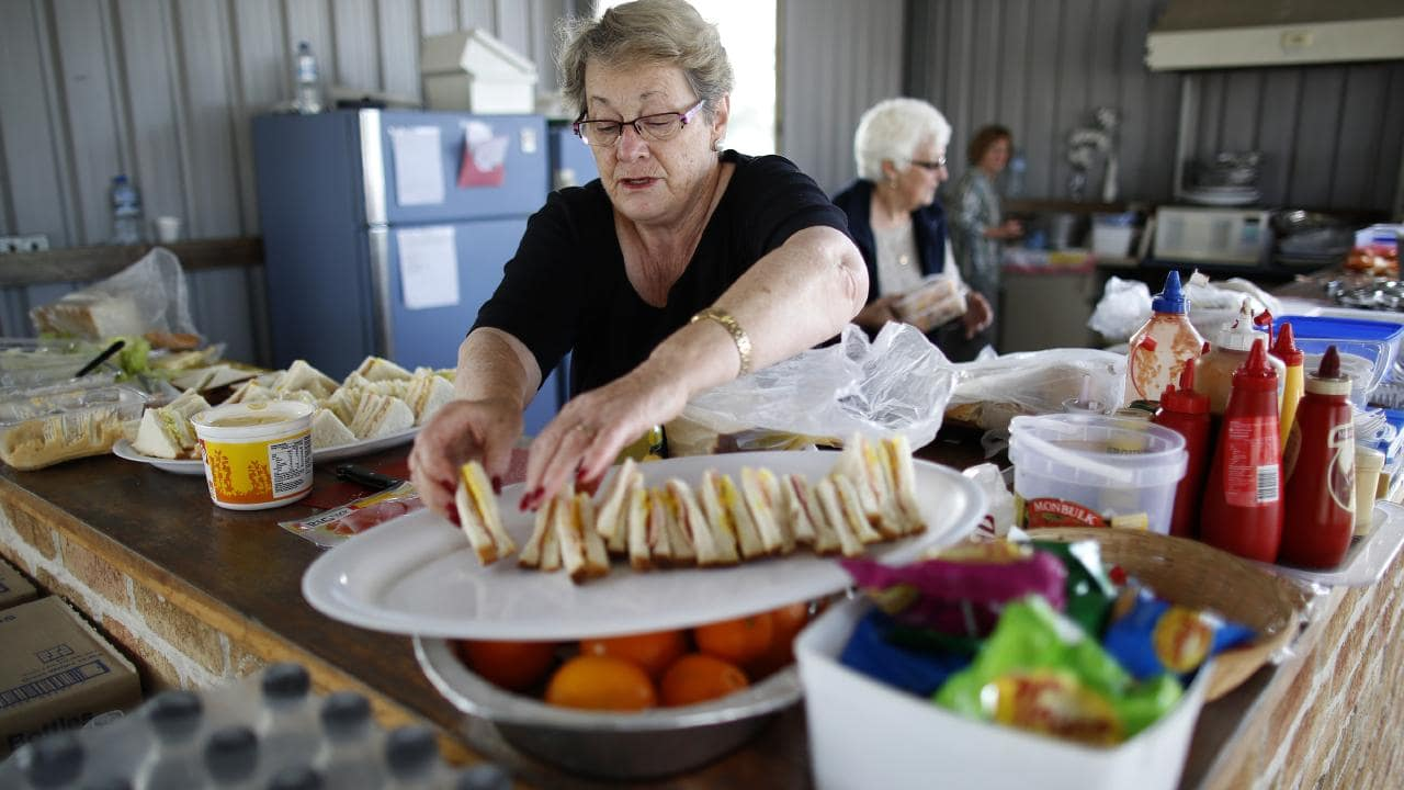 Community volunteers including Heather Miller (above) prepared food for the search teams at Kendall showground. Picture: David Moir
