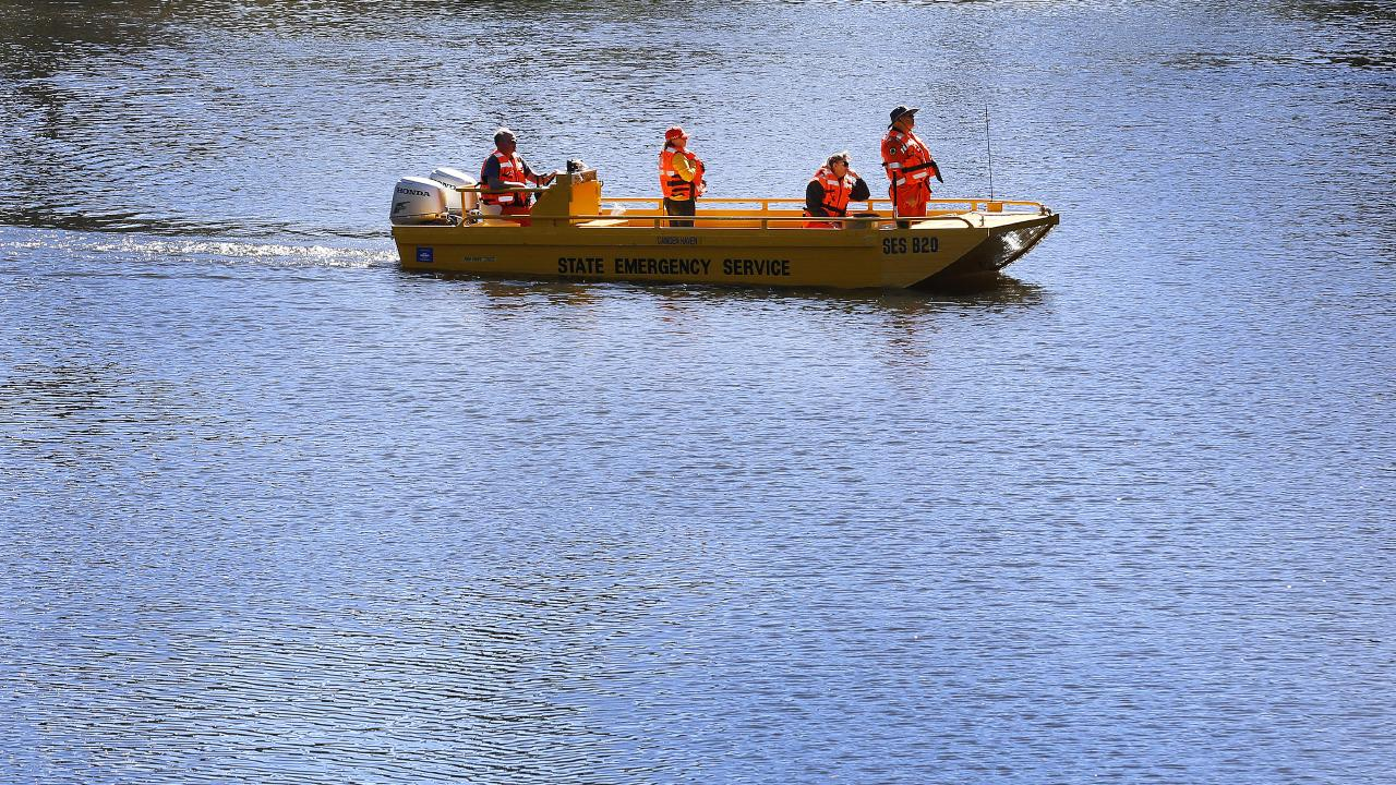SES volunteers search the Camden Haven River in Kendall. Picture: David Moir