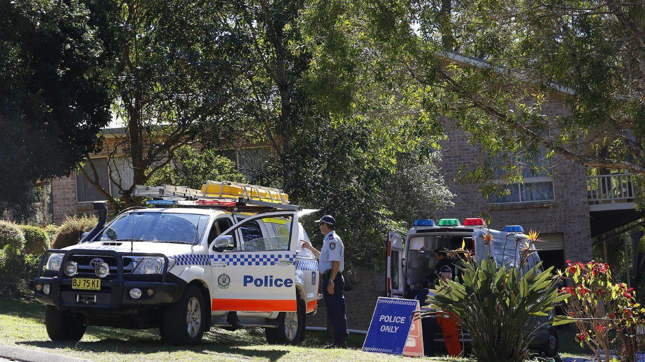 Police in the garden of the house where William Tyrrell went missing in Kendall. Picture: David Moir