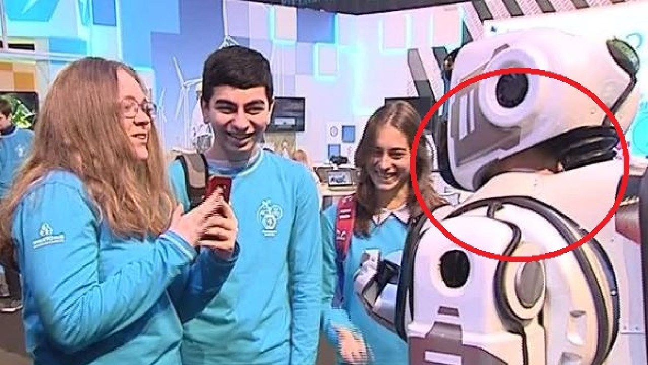 Russian robot turns out to be man in suit.