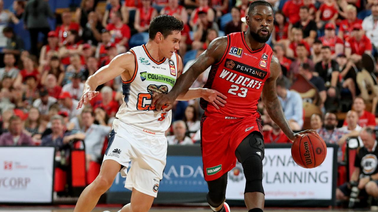 Terrico White (right) of the Wildcats and Jarrod Kenny of the Taipans in action during the Round 8 NBL match between Perth Wildcats and Cairns Taipans at Perth Arena in Perth, Sunday, December 9, 2018. (AAP Image/Richard Wainwright) NO ARCHIVING, EDITORIAL USE ONLY