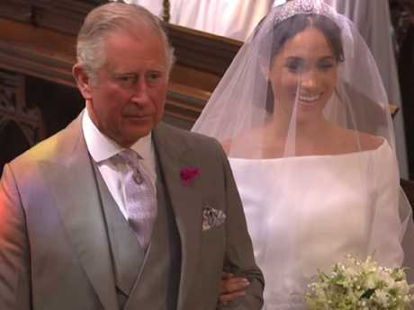 Britain's Prince Charles, Prince of Wales walks Meghan down the aisle. Picture: BBC