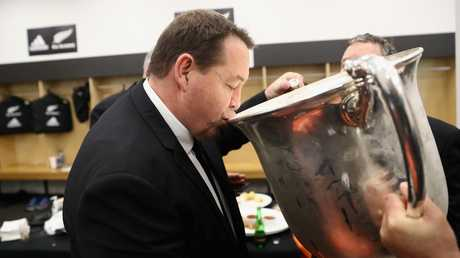 All Blacks coach Steve Hansen drinks from the Bledisloe Cup at Westpac Stadium.