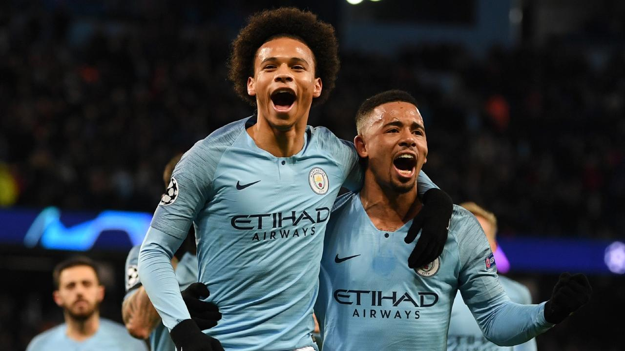 Leroy Sane and Gabriel Jesus of Manchester City celebrate scoring against TSG 1899 Hoffenheim.