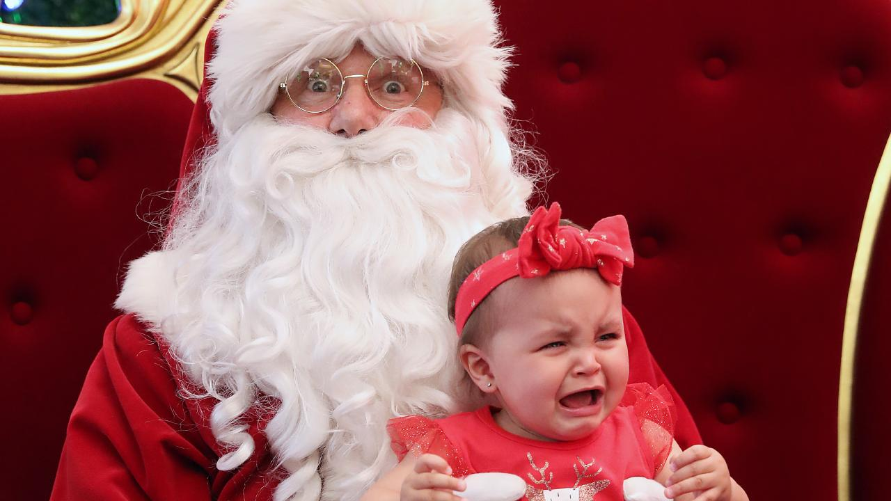 Tots in tears is usually the norm when taking their first photo with Santa