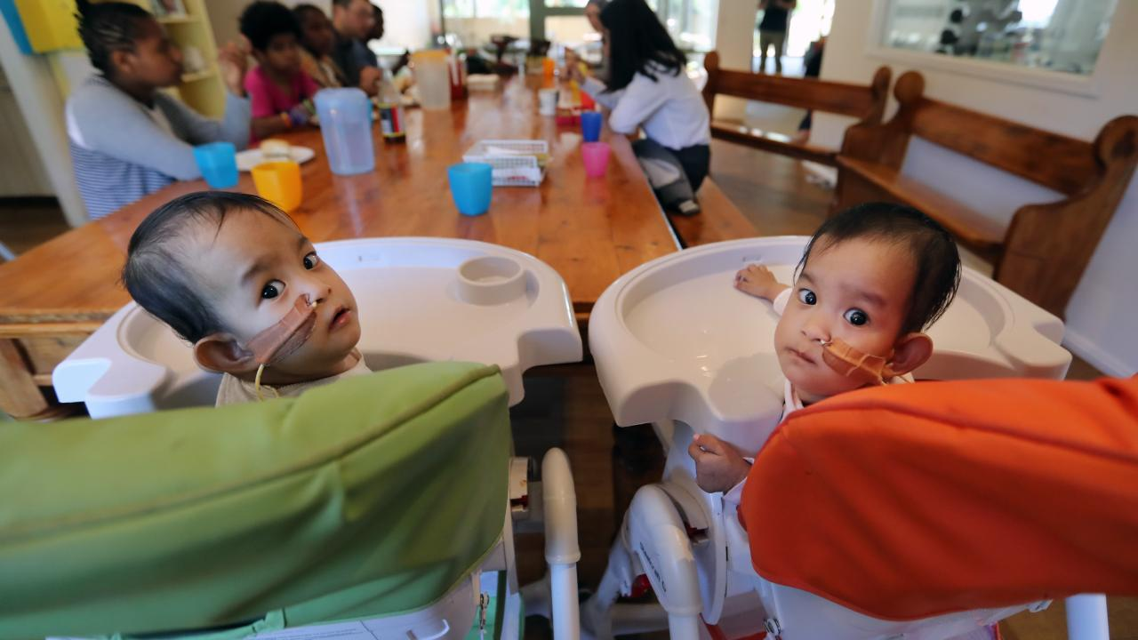 The girls Nima (left) and Dawa (right). having lunch with the other kids in the retreat. Picture: Alex Coppel.