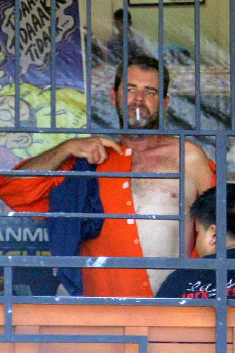 Brendon Luke Johnsson having a smoke in his prison before being presented to the media.