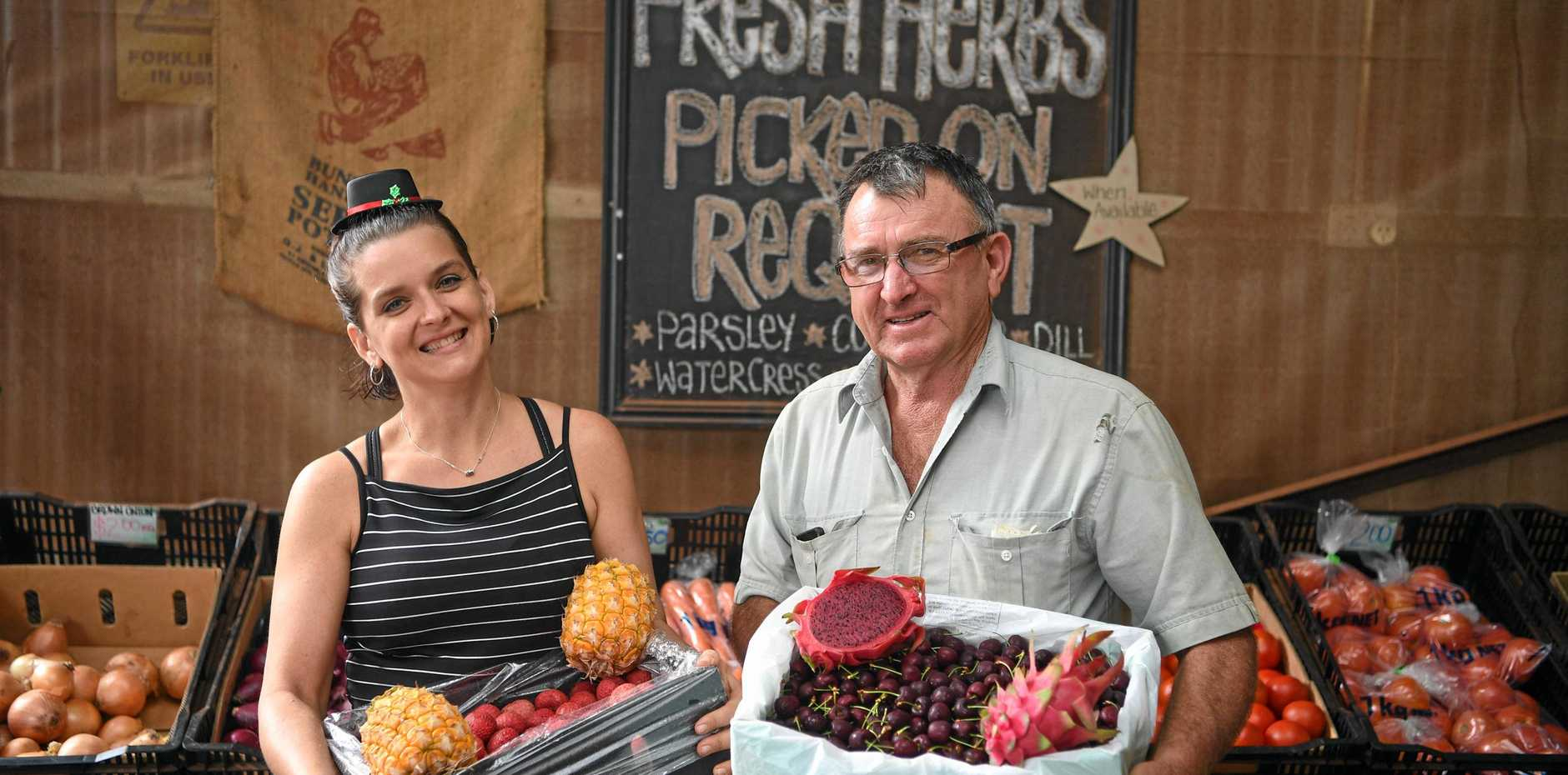 COLOURFUL ARRAY: Mel and Andrew from Drive Thru to the Lettuce Patch display some of their Christmas produce.