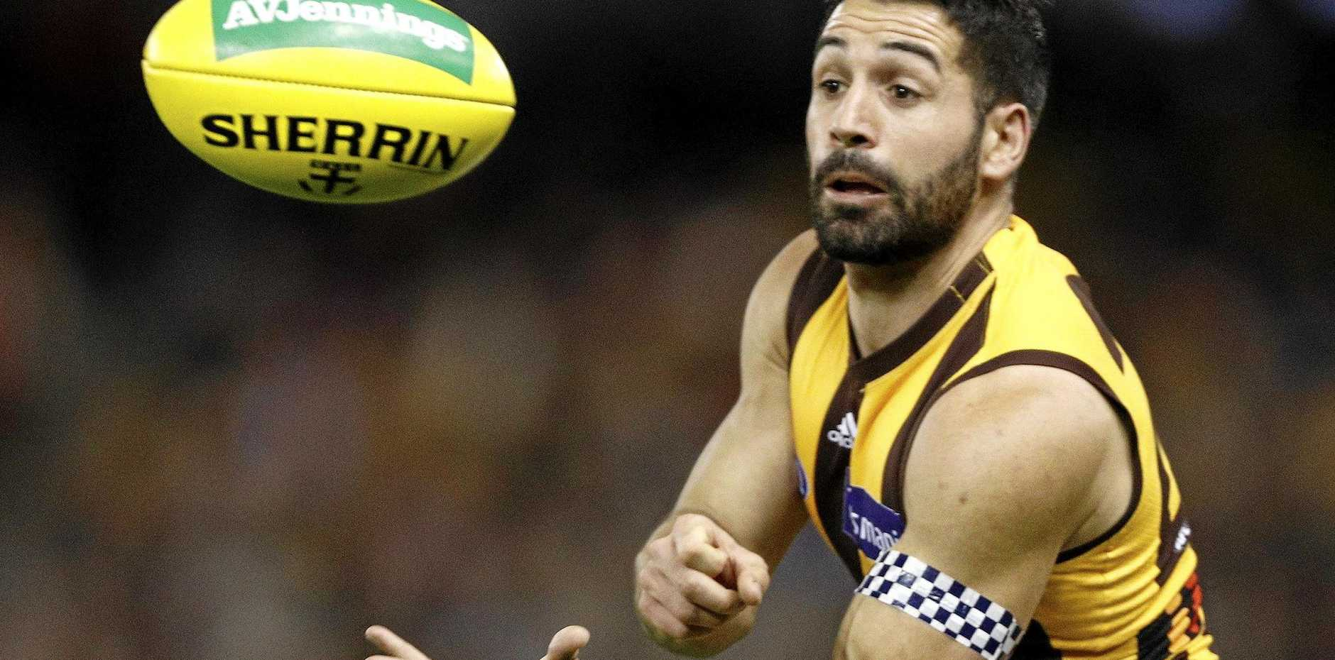 Paul Puopolo of the Hawks hand passes the ball during the Round 22 AFL match between the St Kilda Saints and the Hawthorn Hawks at Etihad Stadium in Melbourne, Saturday, August 18, 2018.