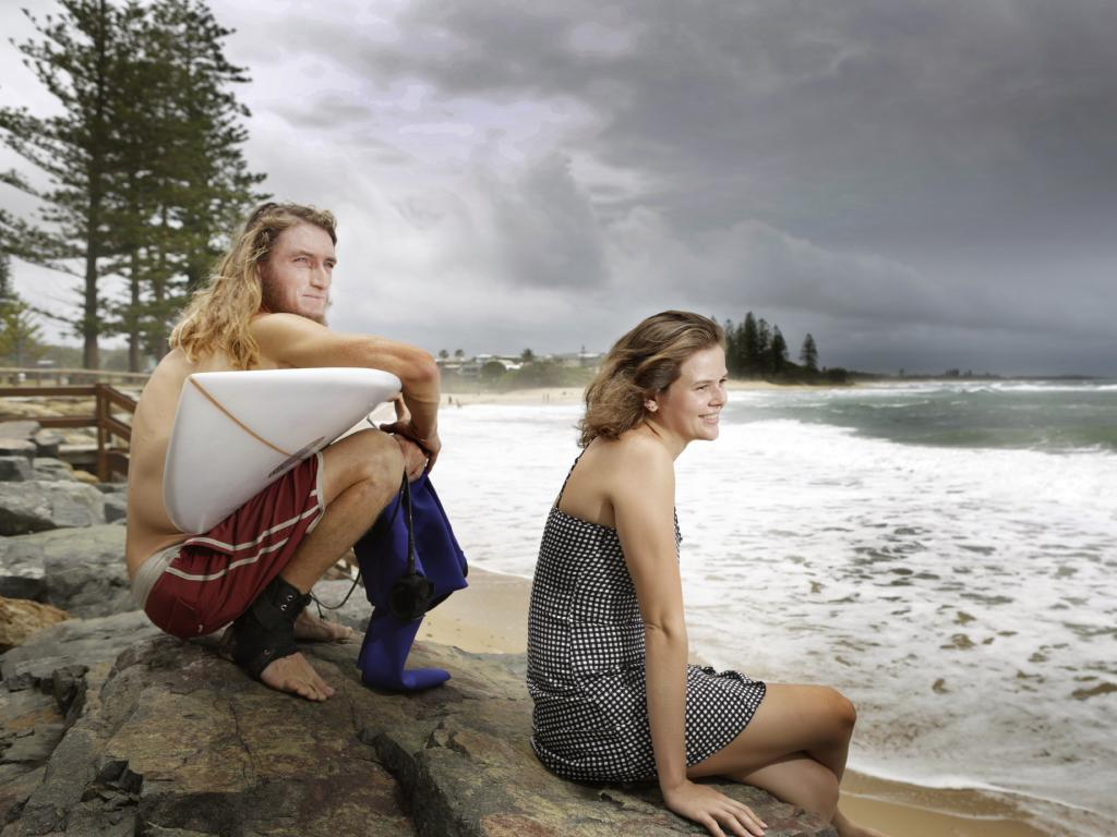 Lewis Tyson, from Graceville, and Lucia Perry, from Tully, at Moffat Beach on Saturday. Picture: AAP/Meghan Slade