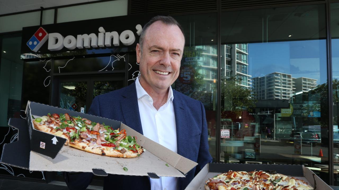 Domino's CEO Don Meij with pizzas at Domino's store. Pic Annette Dew
