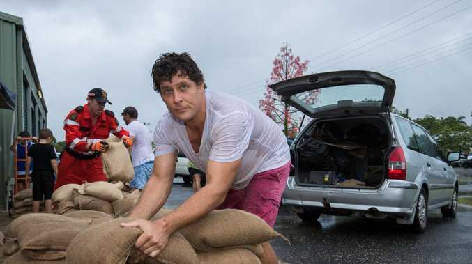 Steve Irving loads sandbags at the SES headquarters in Cairns. Picture: AAP/Marc McCormack