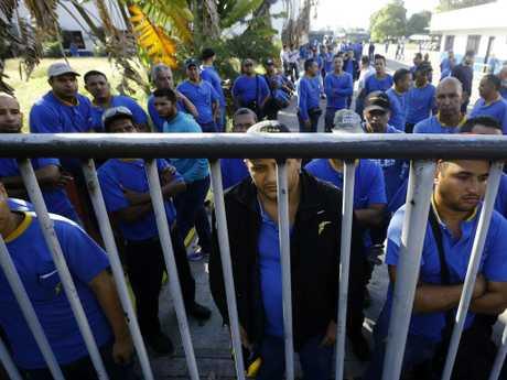 Goodyear workers arrive to find their plant is no longer in operation in Venezuela. Picture: Juan Carlos Hernandez