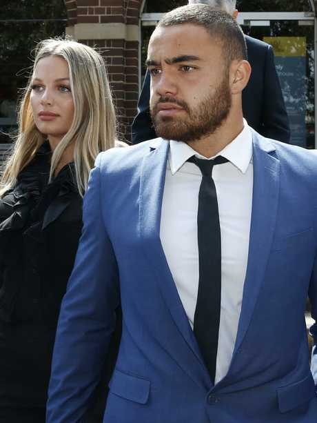 Manly NRL player, Dylan Walker leaves Manly court with his partner, who he is alleged to have assaulted.