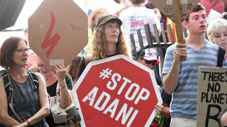 Anti-Adani coal mine protestors engage in a sit-in protest outside the Queensland government headquarters in Brisbane on Wednesday. Picture: AAP/Dan Peled