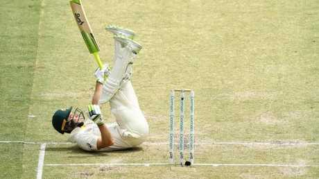 Tim Paine took a tumble during his tough knock. (Photo by Ryan Pierse/Getty Images)