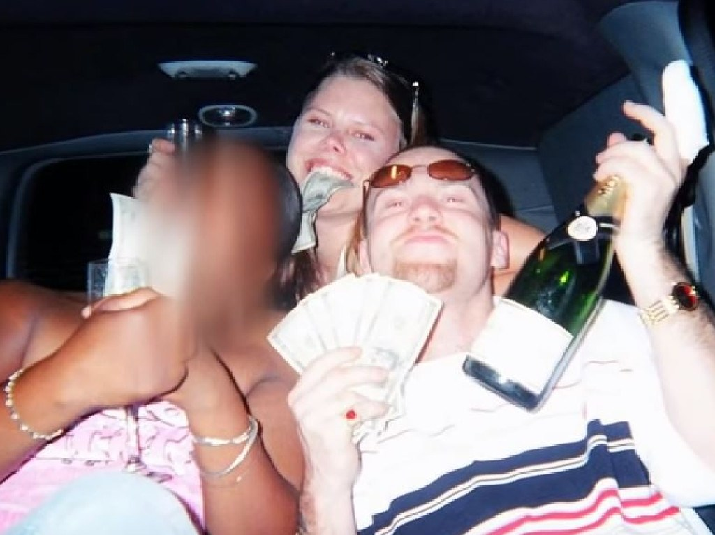 The photo that swayed the jury, Cole and Jackson with cash and booze after burying the couple alive.