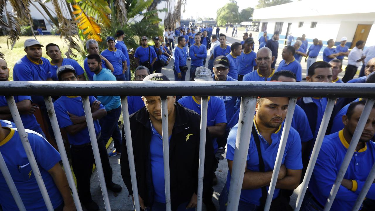 Goodyear workers arrive to find their plant is no longer in operation in Venezuela. Picture: Carlos Hernandez