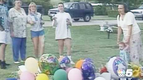 Eight days after her sons' murder, Routier was filmed throwing Silly String on their graves for slain Damon's 7th birthday. Picture: NBC5.