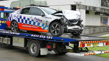 A wrecked police car involved in a collision with an SUV at Tyndale on Sunday morning, leaves Grafton Police Station compound.