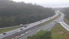 Car crashes on wet and wild Bruce Hwy