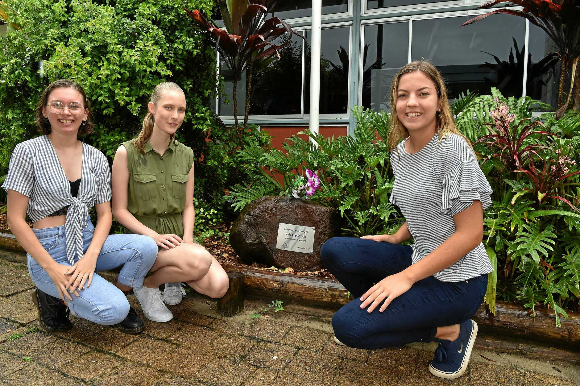 Three students from Burnside State High School students celebrate with an OP1 result.Grace Smith,  Grace Knight and Eden Danielsen-Jensen are pictured at their former classmate Jade Dixson's memorial.
