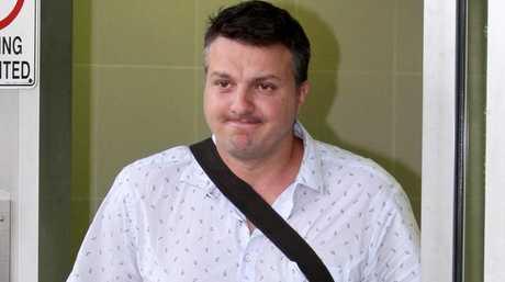 Restaurateur Daniel Milos leaves the Brisbane watchhouse after his arrest