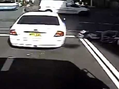 A pedestrian was caught unaware, seen in the top left corner crossing the road. Picture: 7 News