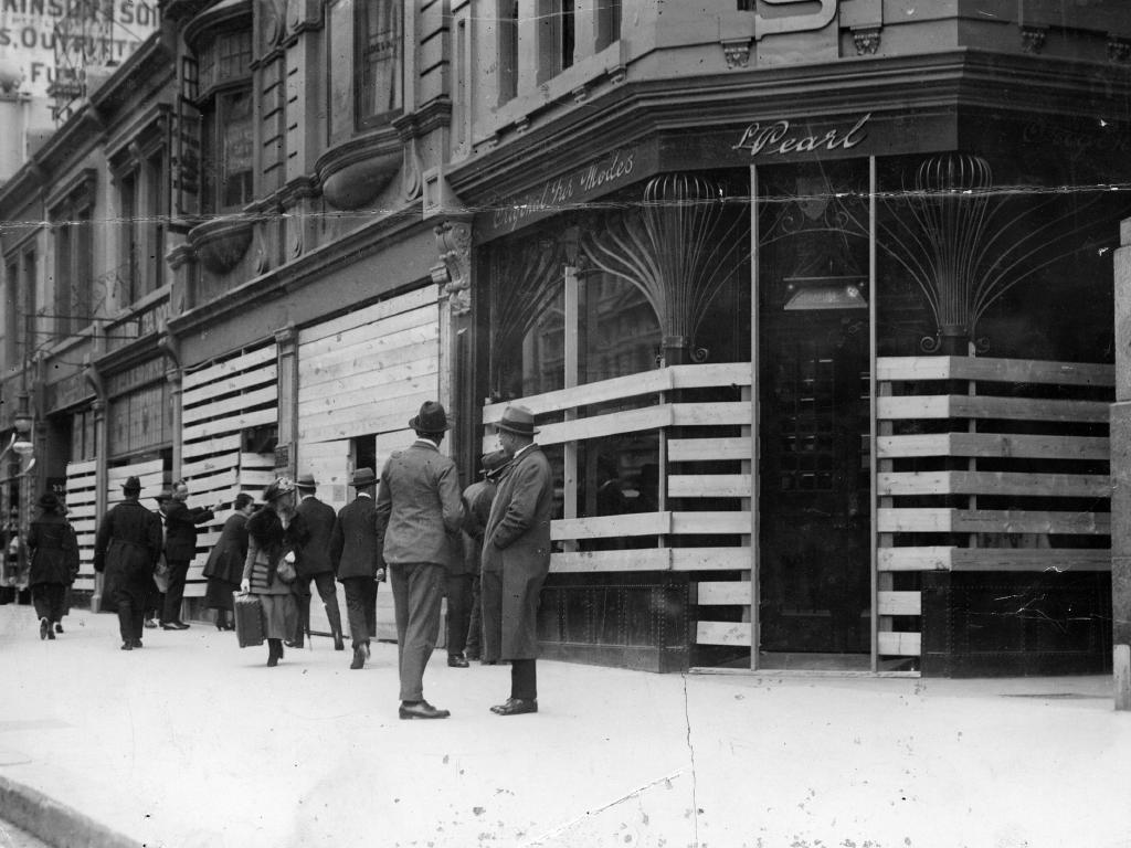 Shops in Collins St barricaded against looters during the police strike.