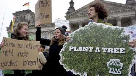 Students protest under the banner of 'Fridays for Future' in front of the Reichstag building, host of the German federal parliament, in Berlin, Germany. Picture: AP