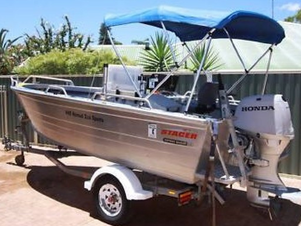 Three men have gone missing after a fishing trip near the Vernon Islands. Their boat is believed to be similar to the one pictured. PICTURE NTPFES