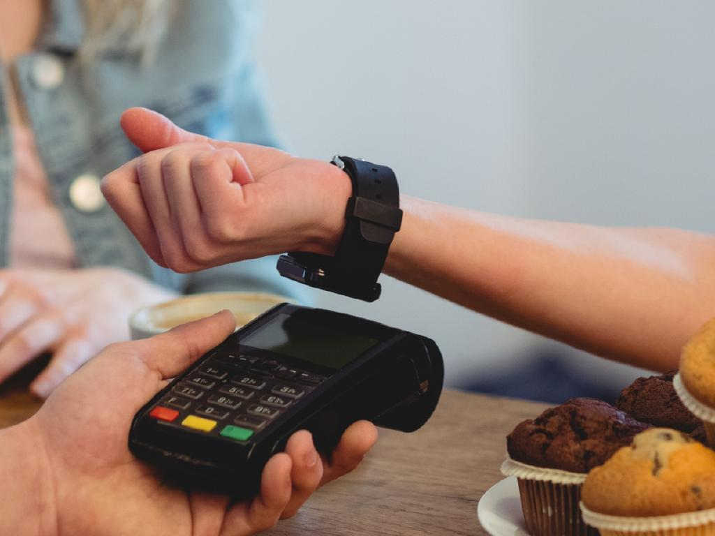 A woman using her smartwatch to pay. Picture: Supplied.