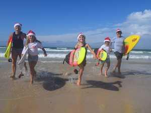 SEASONS GREETINGS: Byron Bay Boardriders Club members