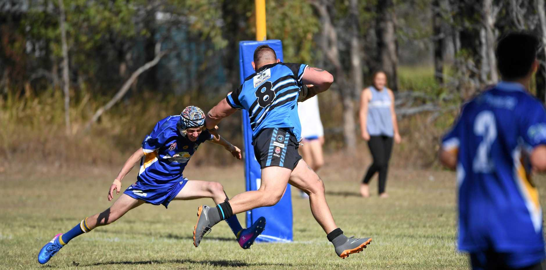 FEND: South Kolan's Jacob Olive gets away from a tackle from Agnes Water's Codie Carmichael. The Marlins are in doubt to play next year in the NDRL.