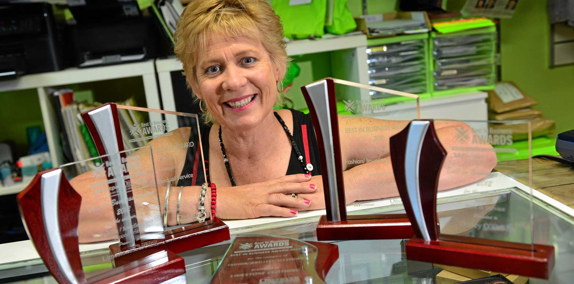 TIME'S UP: Limestone Clothing owner Desley O'Grady with awards collected by the store over the years.