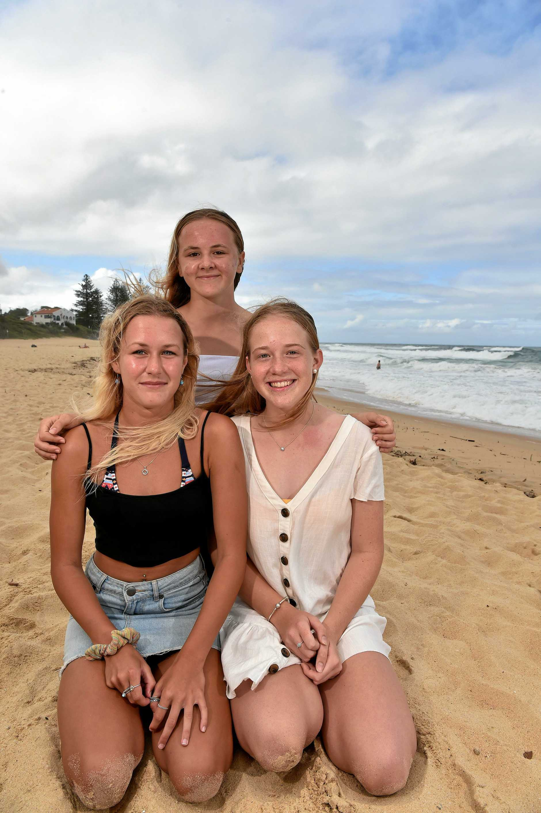 RESCUERS: Keira Waldron,14, Jacinta Strathearn,16, and Paige Gardner,15, helped rescue a family in the surf at Moffat Beach.