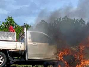 Flames engulf car billowing smoke on Bruce Highway