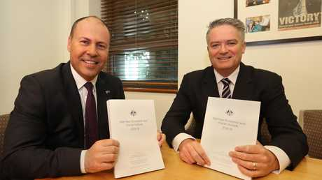All smiles: Treasurer Josh Frydenberg and Finance Minister Mathias Cormann before the release of the mid-year economic and fiscal outlook (MYEFO). Picture: Kym Smith