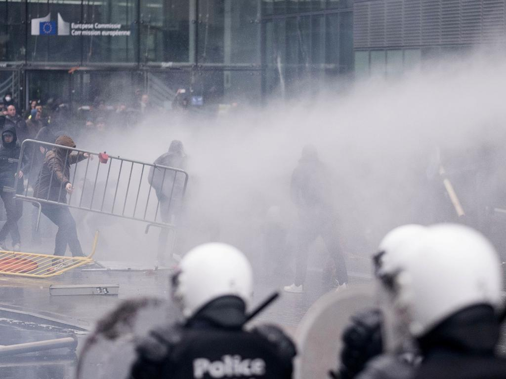 Protesters face off against the police during an anti-migrant demonstration outside of EU headquarters in Brussels. Picture: AP