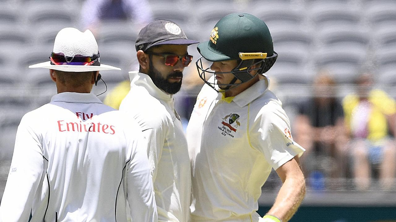 Virat Kohli (left) and Tim Paine clash in Perth. Picture: AAP