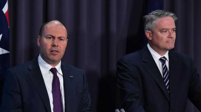 Treasurer Josh Frydenberg and Minister for Finance Mathias Cormann as they hand down the Mid-Year Economic and Fiscal Outlook 2018/19 today. Picture: Mick Tsikas/AAP