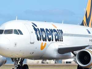 Tigerair flight turned around after 'threat'